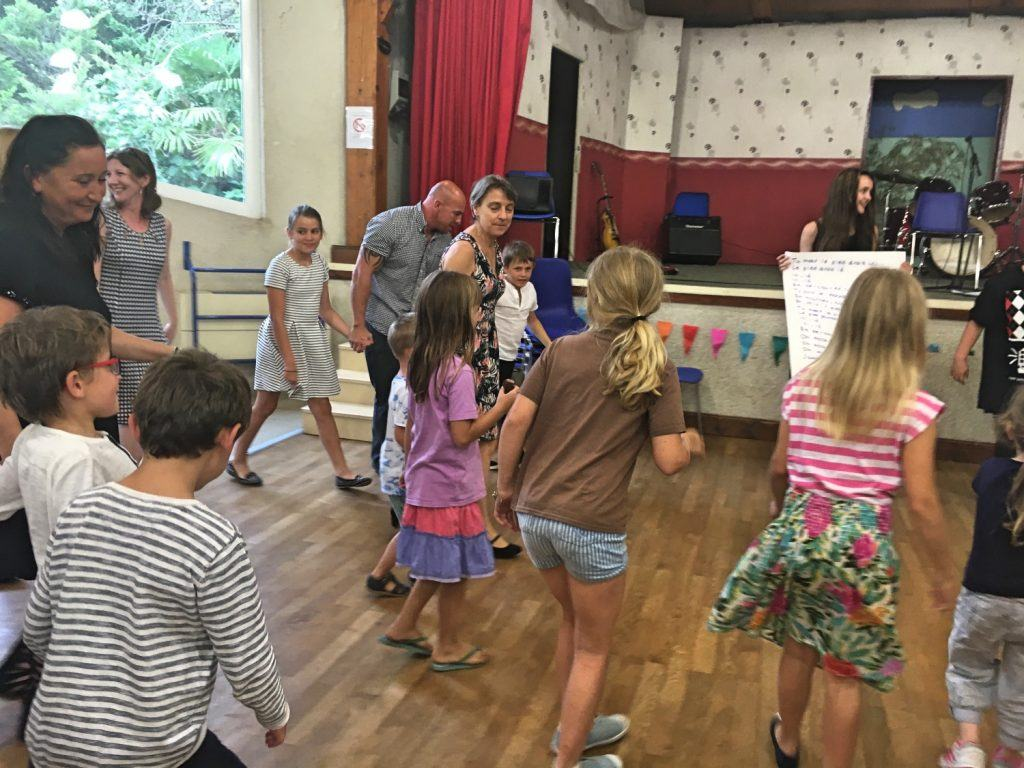 Learning how to do the 'Hokey Pokey' in French, all the adults included!