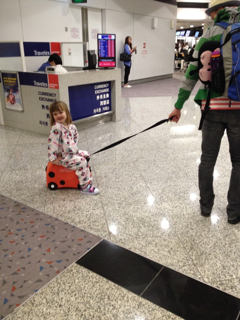 Hong Kong stopover. S was very excited about wearing her pj's at the airport.