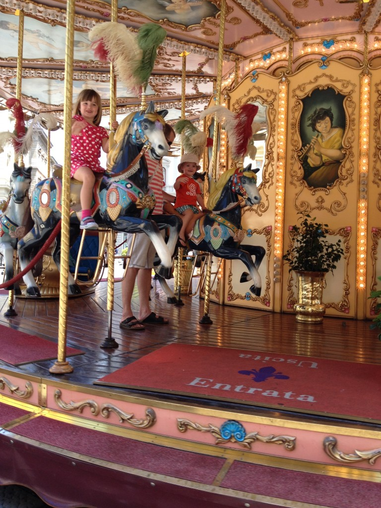 Riding a carousel in Florence
