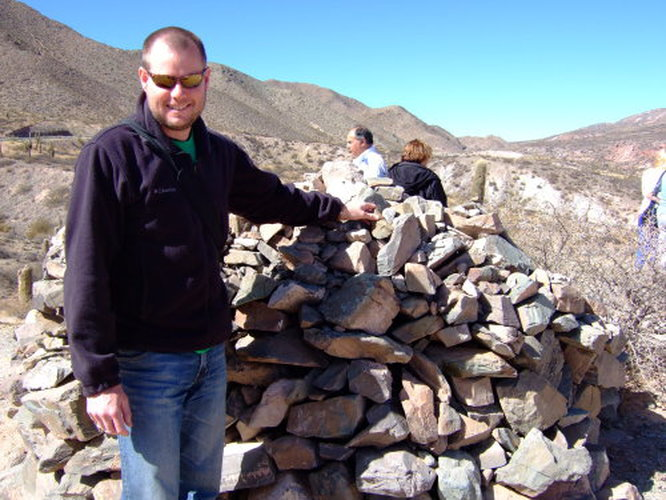 Mike making an offering to Pachamama (Earth Mother) for safe travels. These piles of rocks are everywhere in the desert.