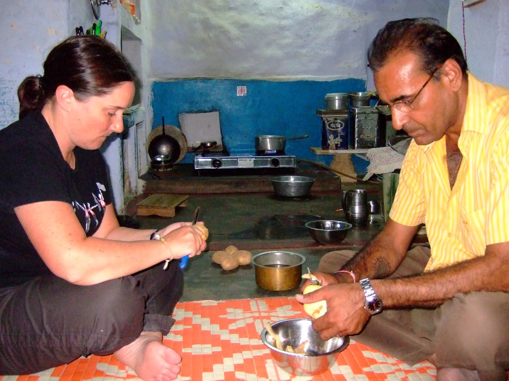 Me and our guide Ashok peeling potatoes for the meal.