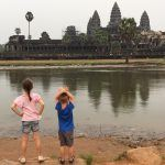 Angkor wat with kids at sunrise