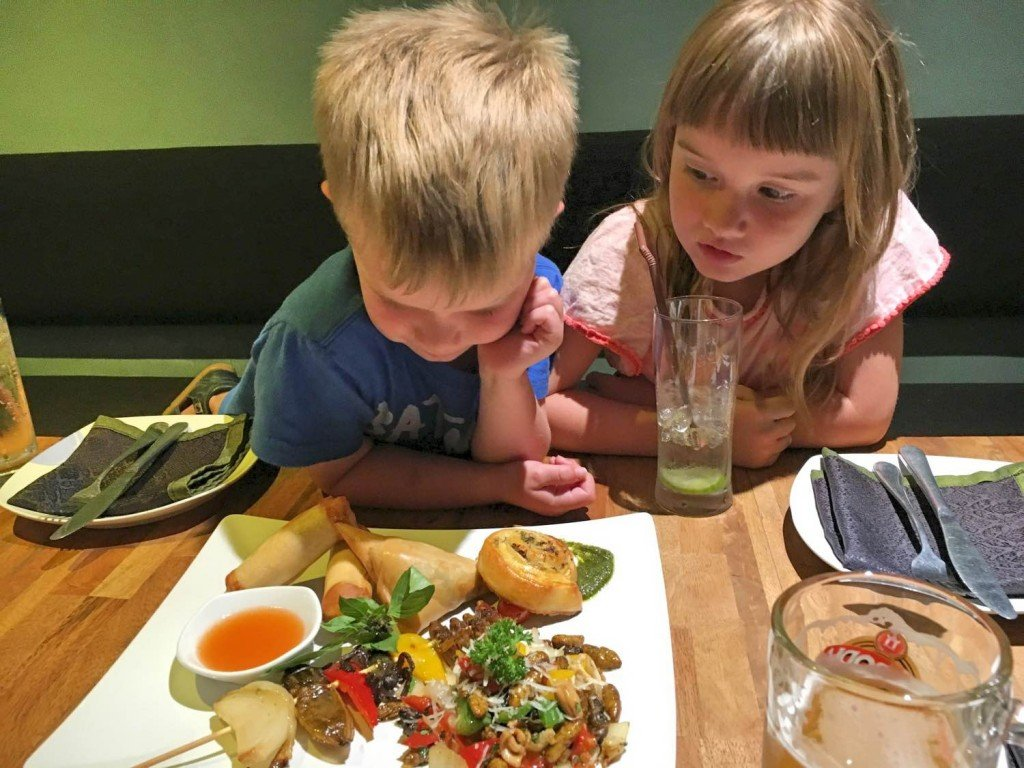 The kids inspecting their insect dinner at the Bug Cafe, Siem Reap