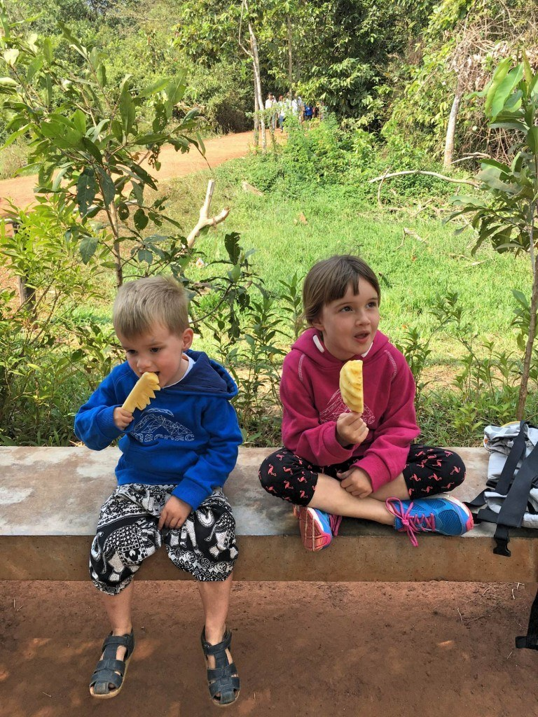 Kids eating pineapple on a stick snack in Cambodia
