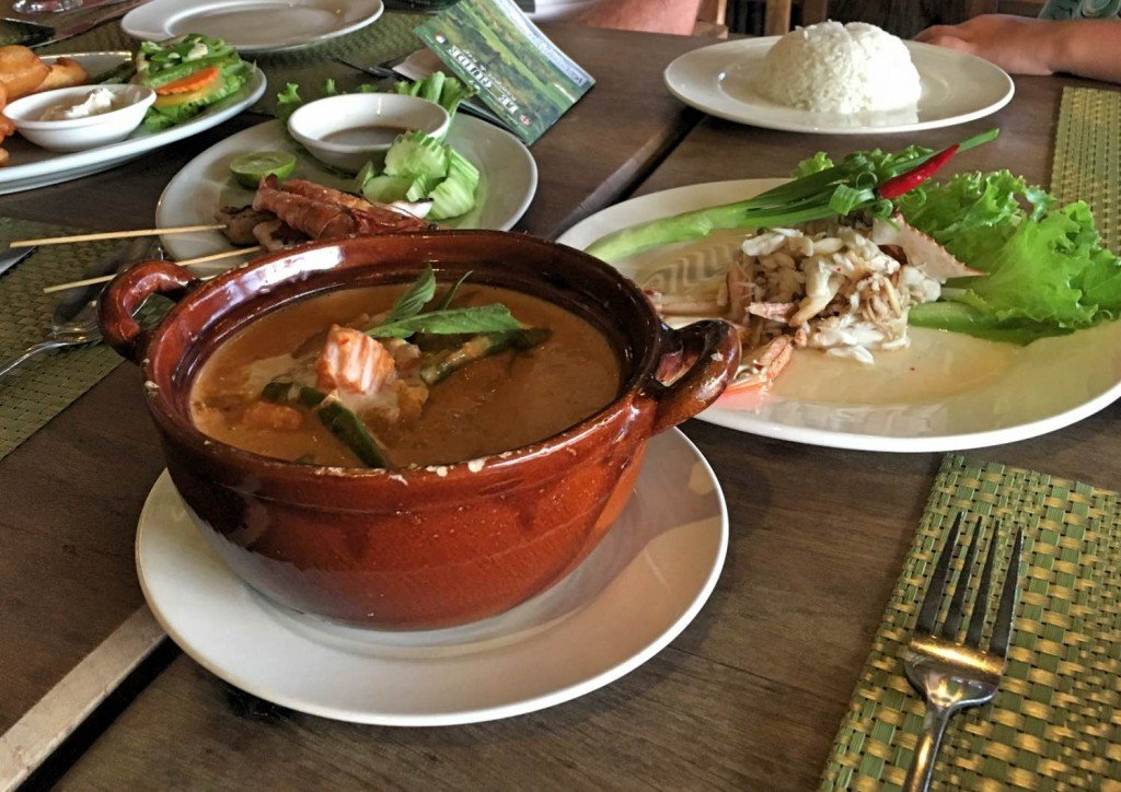 Holy Cram restaurant Kep Khmer curry at the front, crab salad to the right and seafood skewers to the left