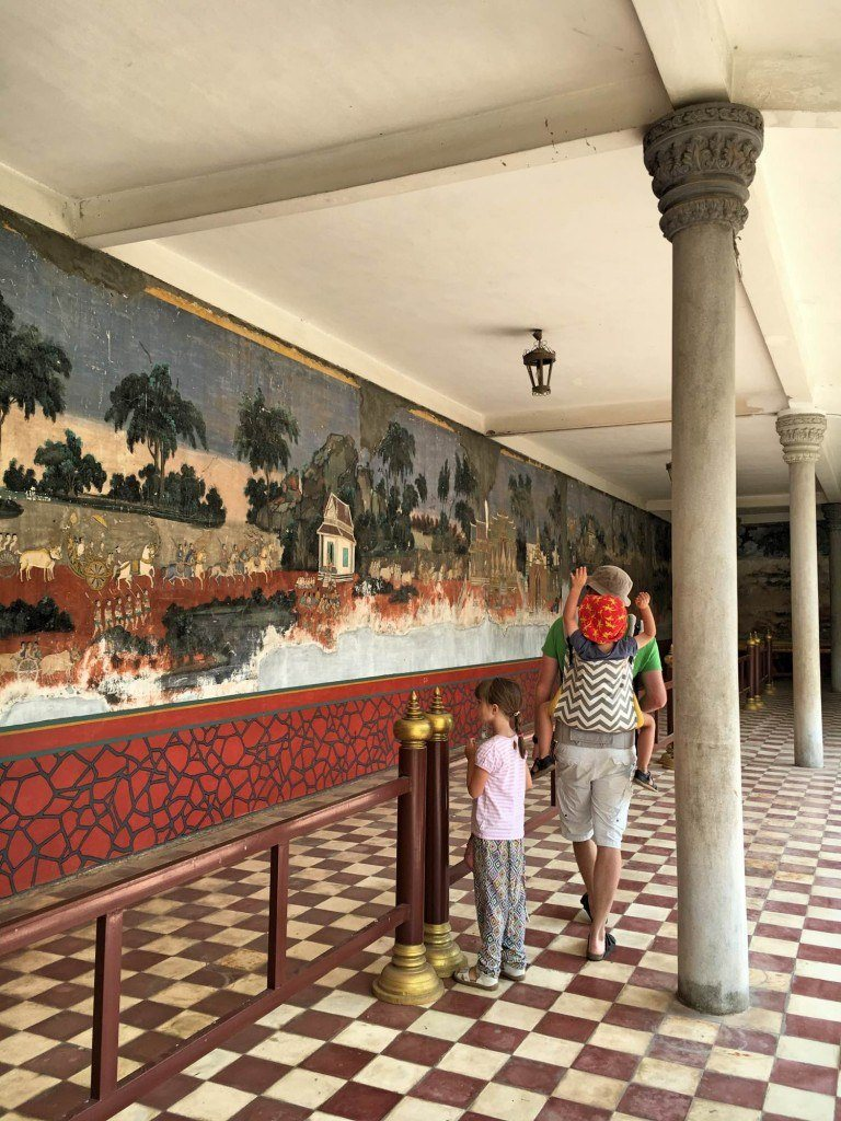 Amazing murals depicting ancient scenes in the history of Cambodia line the walls as you wander around