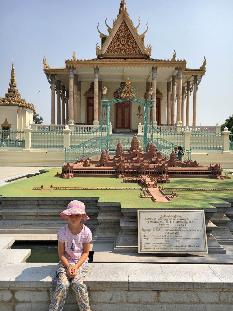 S beside an extremely detailed model of Angkor Wat