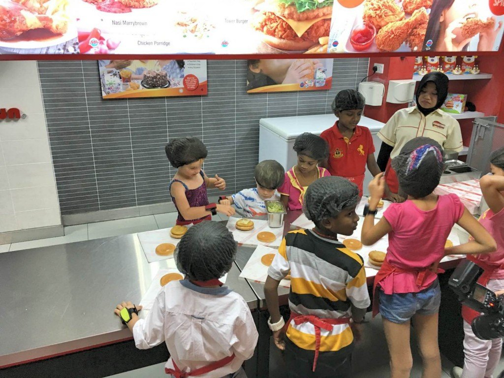 Making chicken burgers at Kidzania KLCC