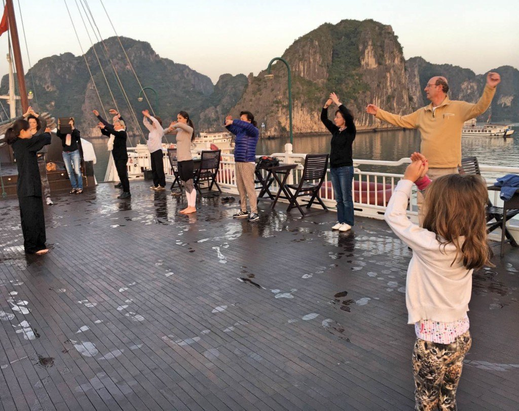 Tai Chi while cruising on the Bhaya II in Halong Bay, Vietnam