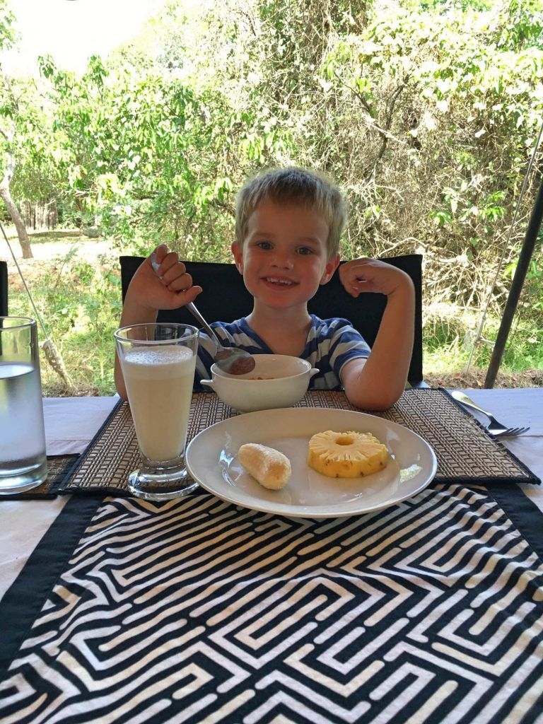 This kid loves breakfast so he was in heaven with his porridge, fruit and banana lassi