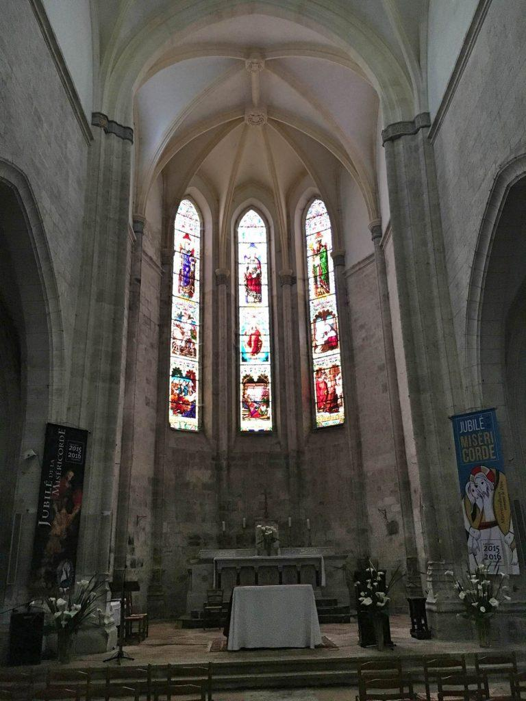 The altar and stained glass windows of the church of Saint Félicien