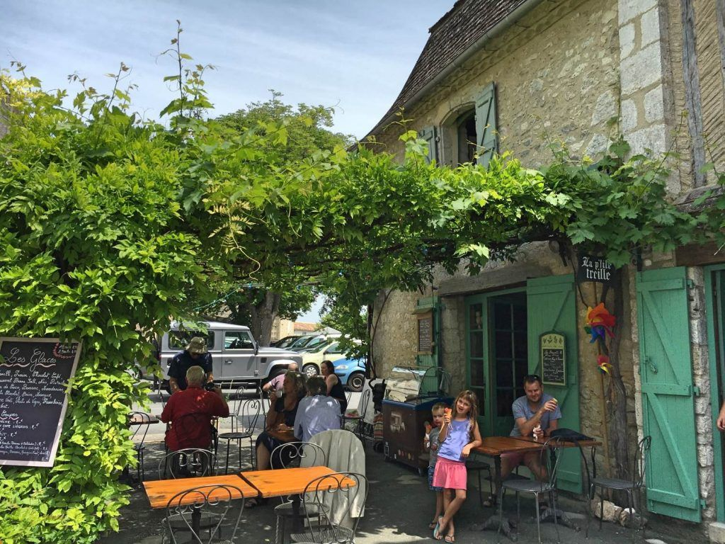 Enjoying an ice-cream at the cafe at the entrance to Issigeac