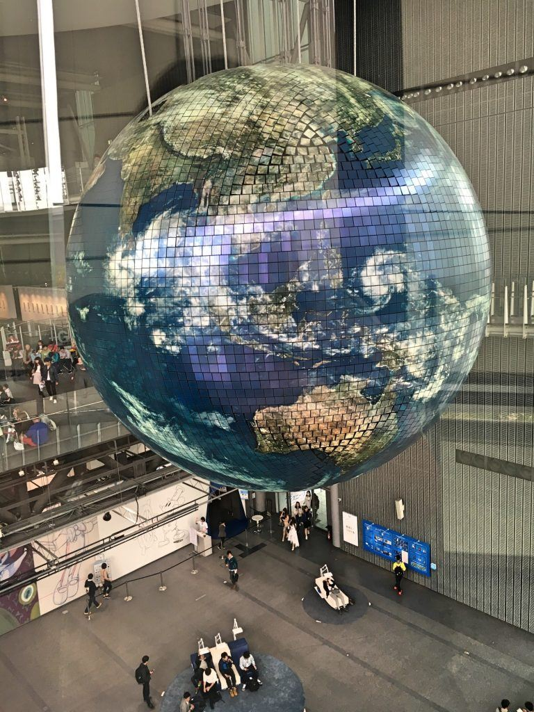 Giant globe hanging from the Miraikan ceiling