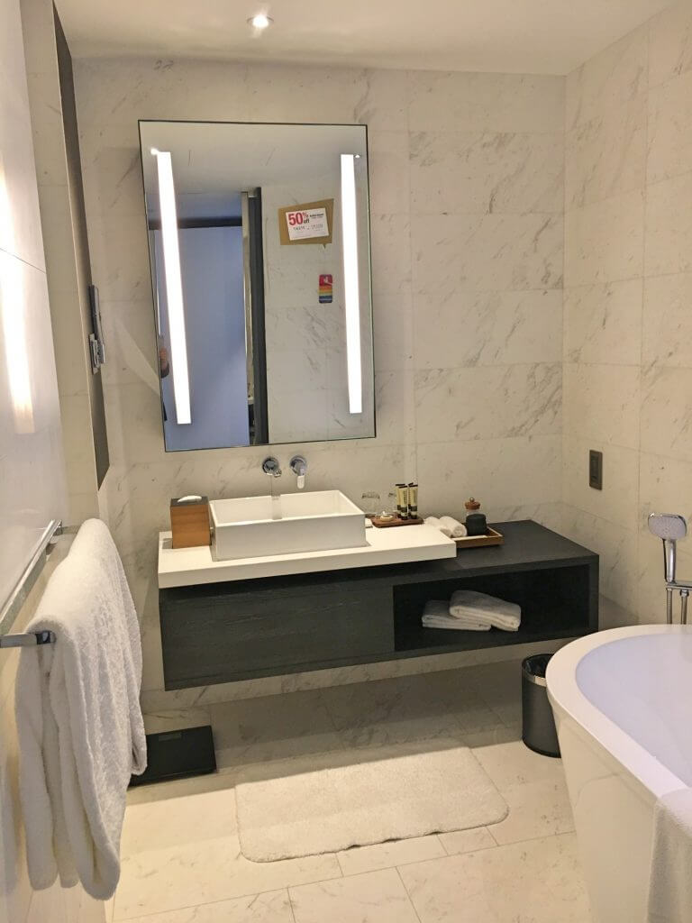 Gorgeous marble bathroom with bath and power shower at G Hotel Kelawai