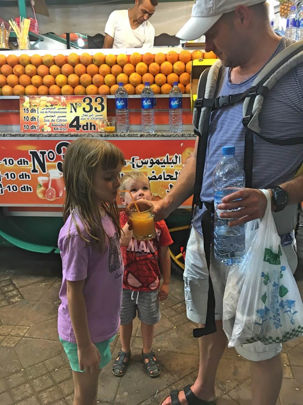 Trying fresh orange juice is a must do on a Morocco family holiday