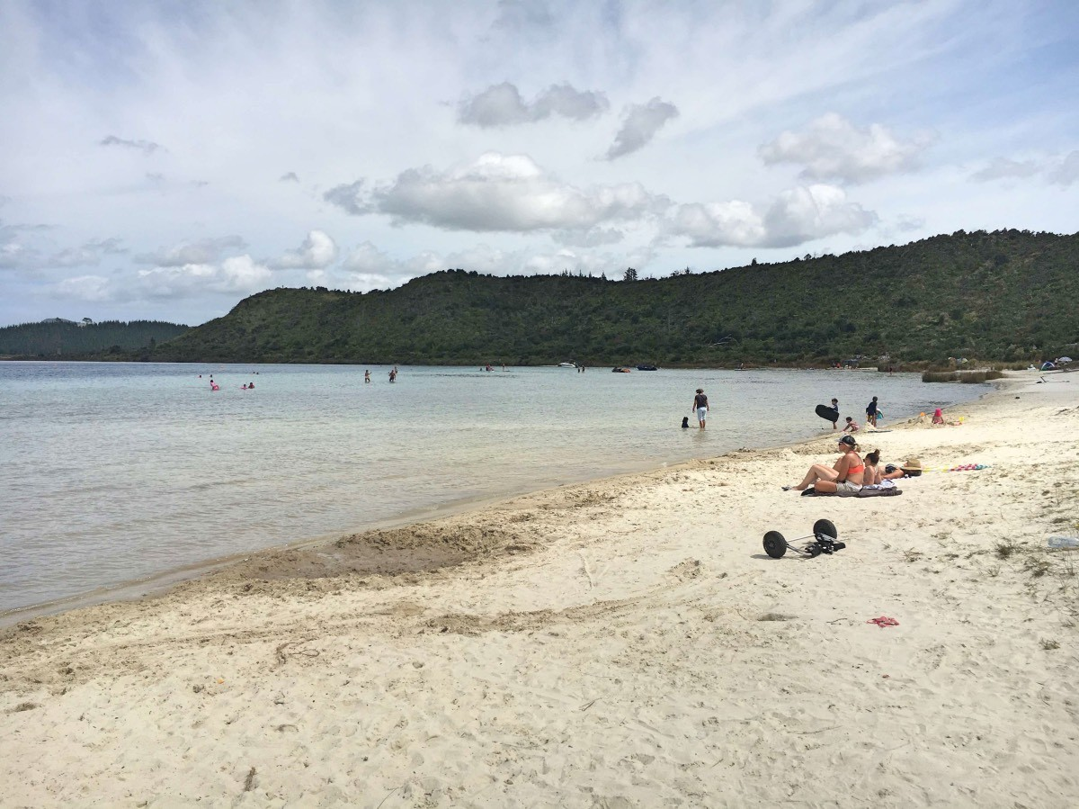 The white sand shores of Kai Iwi Lakes.
