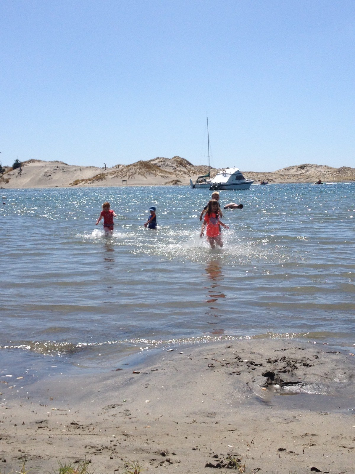 Mangawhai is perfect for kids to splash around at.