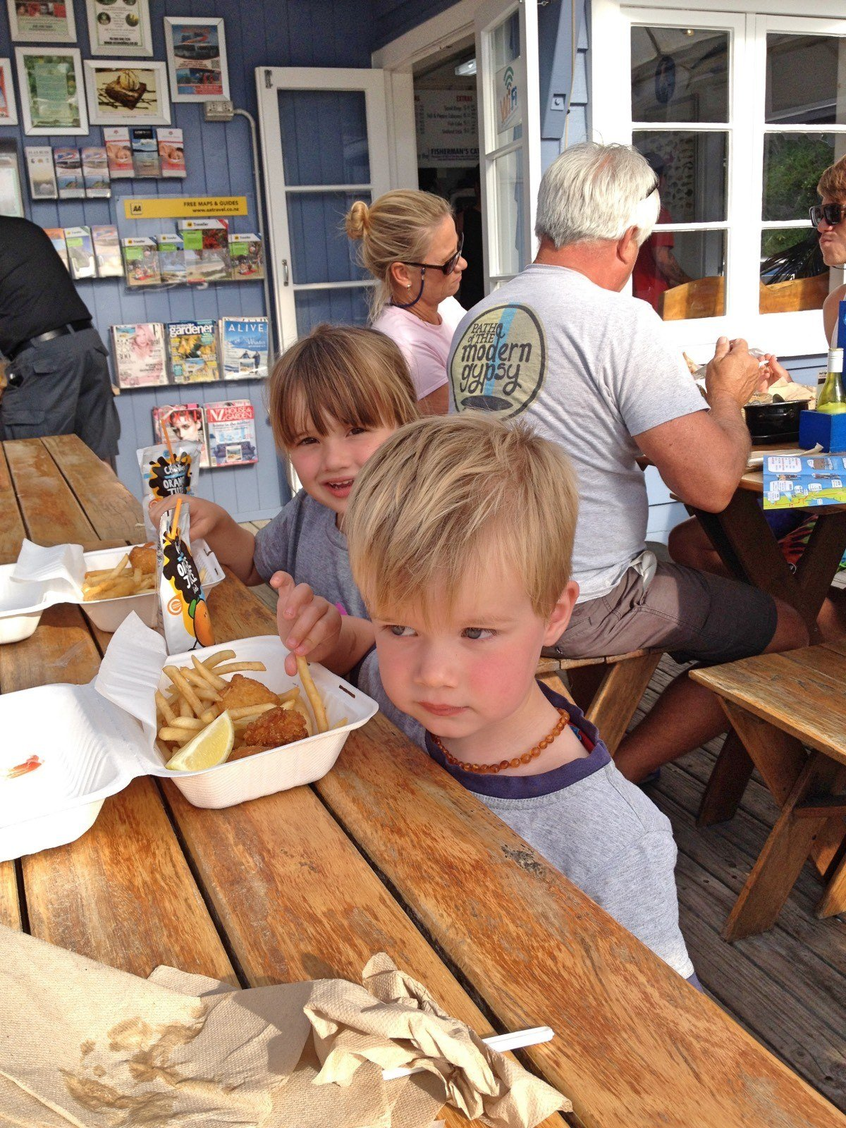 The kids enjoying Mangonui Fish and Chips when they were a bit younger.